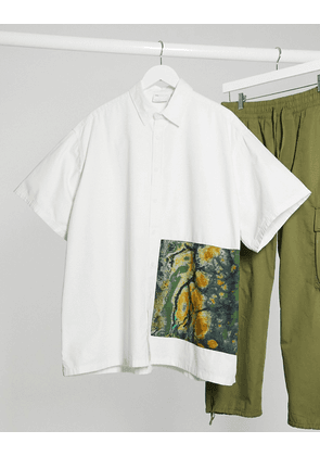 ASOS DESIGN relaxed fit shirt with placement print in white