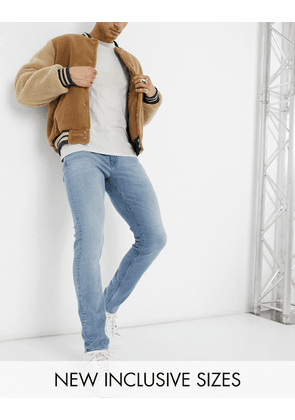 ASOS DESIGN skinny jeans in dusty mid blue wash