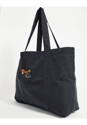 ASOS DESIGN oversized tote bag in soft touch black cotton with mushroom embroidery
