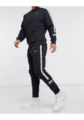 Nike Repeat Pack logo taping cuffed joggers in black