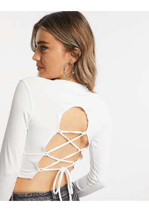 Bershka long sleeve crop top with lace up back in white