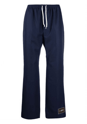 Gucci Gabardine trousers with logo patch - Blue