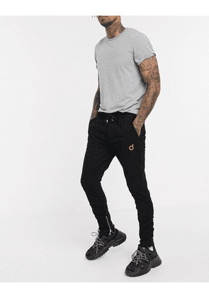 Blood Brother ruched skinny leg trousers in black