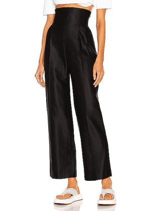 ALAÏA High Rise Twill Straight Leg Pant in Noir - Black. Size 38 (also in 36, 42).
