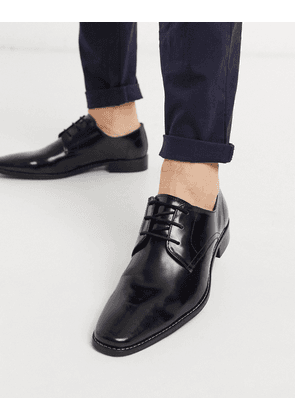 Dune lace up brogue in high shine black leather