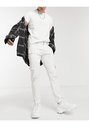 Criminal Damage jeans with utility pockets in washed white