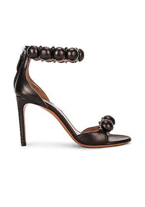ALAÏA Leather Bombe Sandals in Noir - Black. Size 38 (also in 36, 36.5, 39, 39.5).