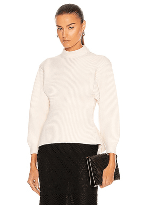 ALAÏA Fitted Sculpted Long Sleeve Sweater in Ivoire - Ivory. Size 36 (also in 38, 40, 42).