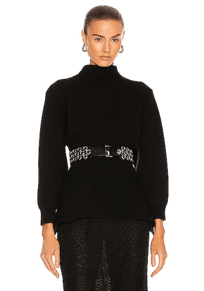 ALAÏA Fitted Sculpted Long Sleeve Sweater in Noir - Black. Size 38 (also in 40, 42).