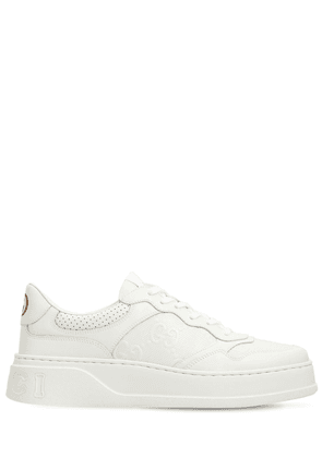 Gg Embossed Leather Sneakers