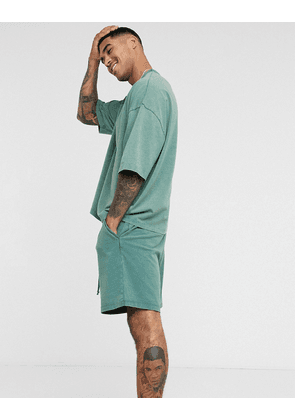 ASOS DESIGN lounge co ord heavyweight shorts in washed green