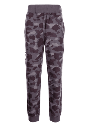 A BATHING APE® camouflage-print cotton track trousers - Purple
