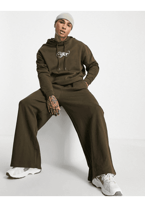 ASOS DESIGN oversized tracksuit in brown with metallic chest print