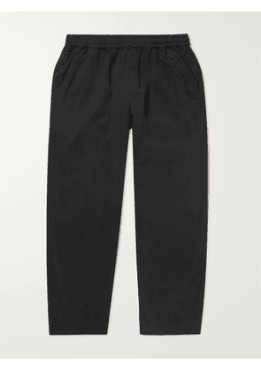 Folk - Assembly Cropped Tapered Pleated Garment-Dyed Cotton-Twill Trousers - Men - Black - 1