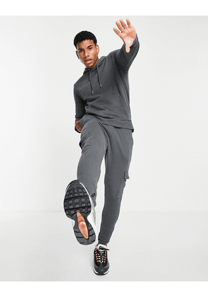 ASOS DESIGN tracksuit with hoodie & skinny cargo joggers in washed black