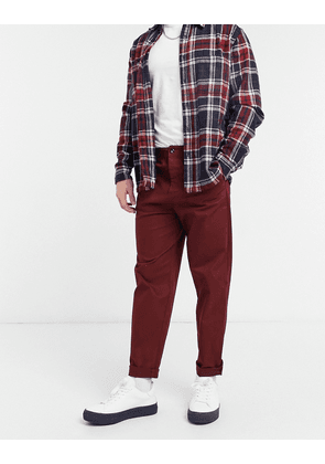 ASOS DESIGN relaxed skater fit chinos in burgundy-Red