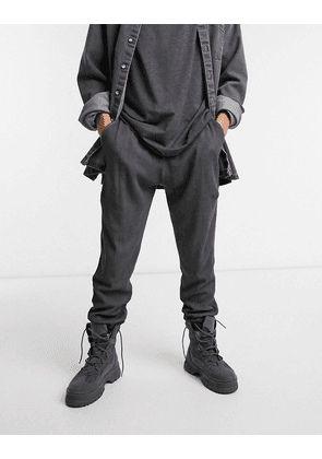 ASOS DESIGN co-ord tapered joggers in oil washed waffle with fixed hem in washed black-Grey