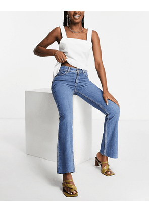 ASOS DESIGN high rise '70's' stretch flare jeans in midwash-Blue