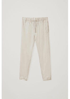 RELAXED-FIT CUFFED PANTS