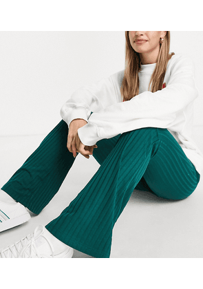 Only exclusive ribbed flared trousers in dark green